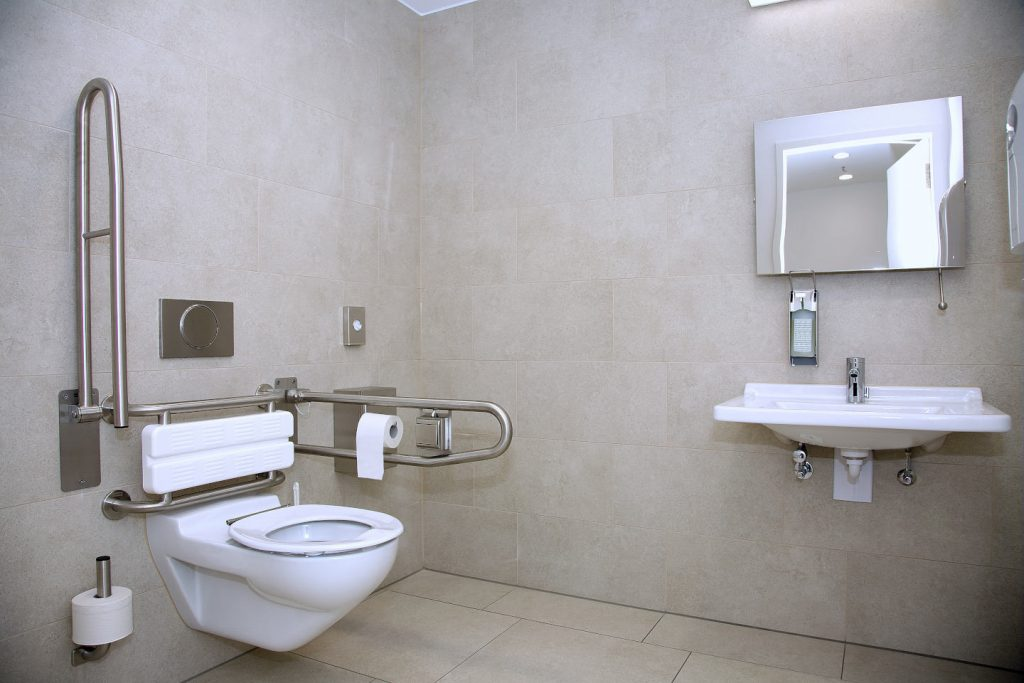 Modern handicapped bathroom for the elderly and disabled, with grab bars and wheelchair access